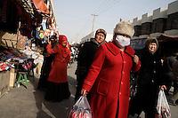 Uighurs walk through the Grand Bazaar in Kashgar, Xinjiang, China.