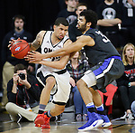SIOUX FALLS, SD: MARCH 5: Kason Harrell #32 of IPFW reaches on Marcus Tyus #23 of Omaha during the Summit League Basketball Championship on March 5, 2017 at the Denny Sanford Premier Center in Sioux Falls, SD. (Photo by Dick Carlson/Inertia)