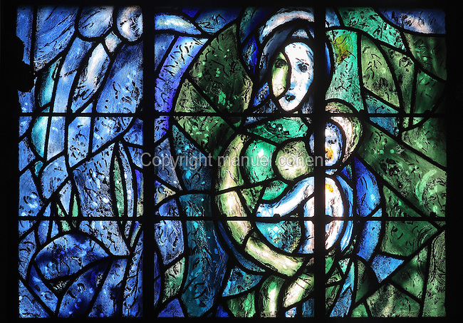 Virgin and child, stained glass window, 1974, by Marc Chagall, 1887-1985, with the studio of Jacques Simon, in the axial chapel of the apse of the Cathedrale Notre-Dame de Reims or Reims Cathedral, Reims, Champagne-Ardenne, France. The cathedral was built 1211-75 in French Gothic style with work continuing into the 14th century, and was listed as a UNESCO World Heritage Site in 1991. Picture by Manuel Cohen