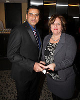 Montreal, Canada - Jan 5 - The Montreal Port Authority CEO, Mrs. Sylvie Vachon, congratulates Captain Anuj Kararia of the Valencia Express vessel who wins the 2015 Gold-Headed Cane, January 15, 2015.