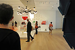 """Visitors pass through the design display of the recently unveiled Modern Wing of the Art Institute Chicago, designed by architect Renzo Piano on the first """"free Tuesday"""" where admission costs nothing and is open to the public, in Chicago, Illinois on May 19, 2009."""