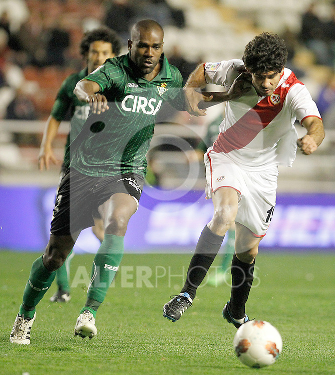 Rayo Vallecano's Diego Costa (r) and Betis' Paulao during La Liga match.March 17,2012. (ALTERPHOTOS/Acero)