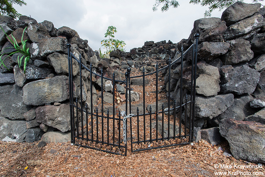 A locked gate at the entrance of Ohi'amukumuku Heiau in Kailua-Kona, Big Island