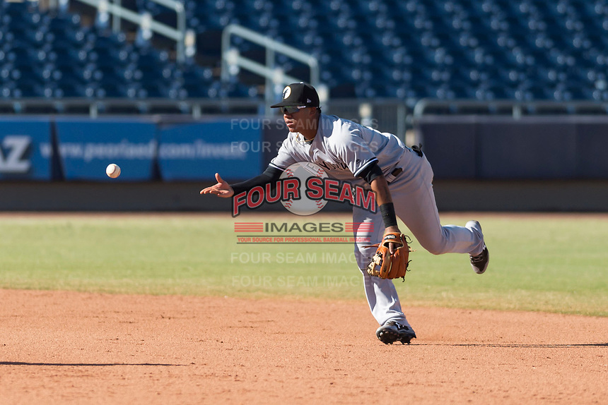 Glendale Desert Dogs shortstop Thairo Estrada (90), of the New York Yankees organization, flips the ball to second base to start a game-ending double play during an Arizona Fall League game against the Peoria Javelinas at Peoria Sports Complex on October 22, 2018 in Peoria, Arizona. Glendale defeated Peoria 6-2. (Zachary Lucy/Four Seam Images)