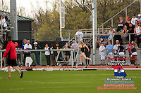 With her former high school hurdles coach at Jefferson City Kirk Obermiller timing her with his trademark form: arm fully extended up and out with stopwatch in hand,  Leslie Farmer nears the finish line in the women's 400 hurdles at the 2012 Missouri Relays. Farmer won the race in a meet record time of 59.12, beating Lincoln University All-Americans Michelle Cumberbatch and Yanique Haye.