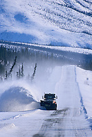 Department of transportation snow plow clears blowing snow from the James Dalton Highway, Brooks Range (Haul Road) Alaska