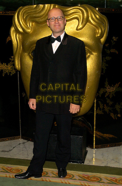 ADRIAN EDMONDSON.At the British Academy Television Craft Awards (BAFTA), the Dorchester, London, England..April 22nd, 2007.full length black tuxedo jacket bow tie glasses .CAP/BEL.©Belcher/Capital Pictures