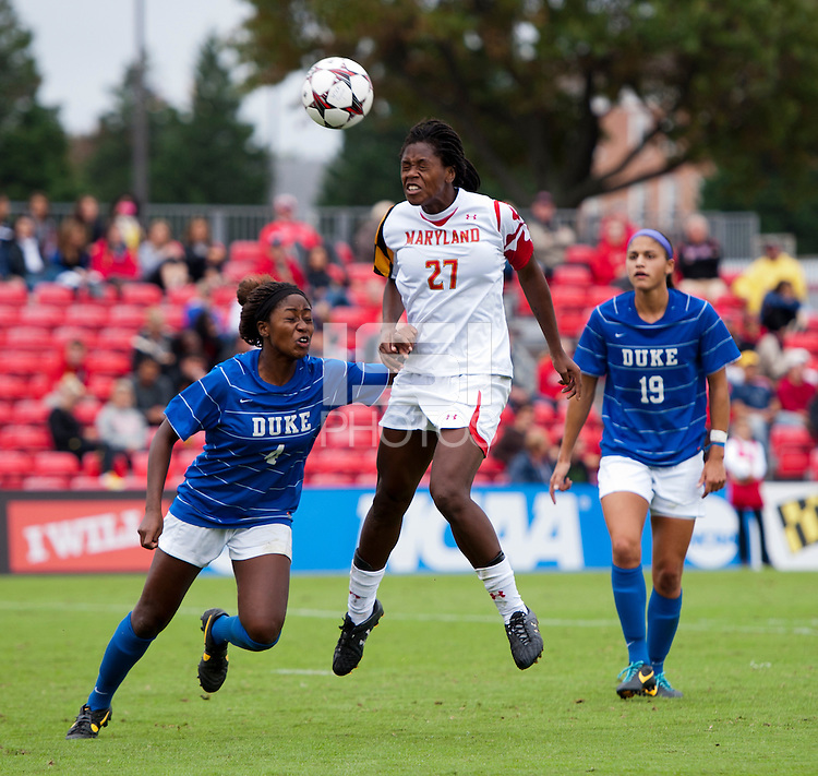 Hayley Brock (27) of Maryland heads the ball away from Natasha Anasi (4) of Duke at Ludwig Field on the campus of the University of Maryland in College Park, MD. DC. Duke defeated Maryland, 2-1.