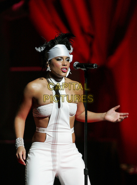 ALICIA KEYS.Performing to a sold out crowd at The Kodak Theatre in Hollywood, California..March 16th, 2005.half length white  cut out cut away headband  bracelet halterneck dancing.www.capitalpictures.com.sales@capitalpictures.com.Supplied By Capital PIctures