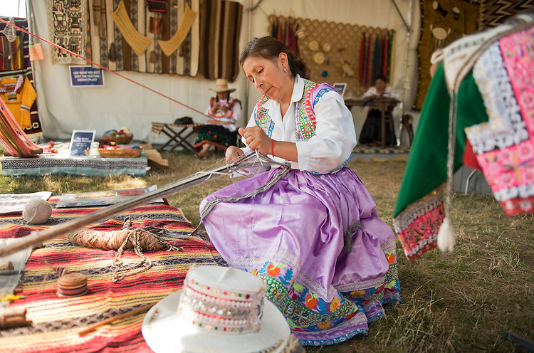 UNITED STATES - JULY 07:  Danitza Lourdes Ramos de Gonalez, a weaver from Peru, works on a rug in the Peace Corps section of the Smithsonian Folklife Festival held on the National Mall.  This year's festival features the country of Colombia, Rhythm and Blues music, and the Peace Corps.  (Photo By Tom Williams/Roll Call)