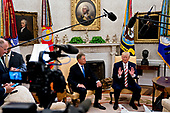 """United States President Donald J. Trump, right, speaks as Klaus Iohannis, Romania's president, listens during a meeting in the Oval Office of the White House in Washington, D.C., U.S., on Tuesday, Aug. 20, 2019. Trump said today he's """"not ready to make a deal with China,"""" but adds Beijing wants an agreement and something could happen soon. <br /> Credit: Andrew Harrer / Pool via CNP"""