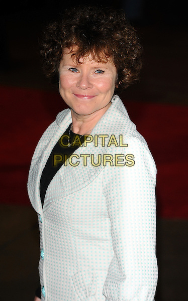 IMELDA STAUNTON .attending the 'Another Year' premiere during the 54th BFI London Film Festival at the Odeon Leicester Square, London, England, UK, October 18th 2010..LFF half length white jacket black top side blue patterned .CAP/CJ.©Chris Joseph/Capital Pictures.