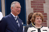 Washington, DC - March 19, 2015: His Royal Highness The Prince of Wales stands with Sonia Gutierrez in front of the Carlos Rosario Public Charter School in the District of Columbia, March 19, 2015, during a four-day USA visit. Gutierrez is one of the original founders of the school. (Photo by Don Baxter/Media Images International)