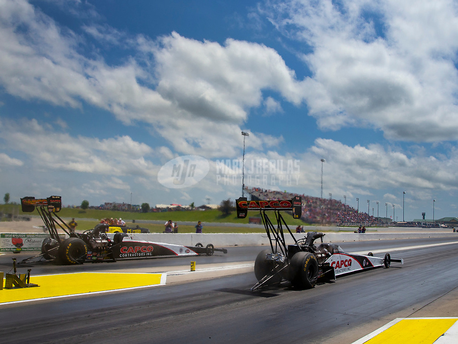May 19, 2018; Topeka, KS, USA; NHRA top fuel driver Steve Torrence (right) races alongside father Billy Torrence during qualifying for the Heartland Nationals at Heartland Motorsports Park. Mandatory Credit: Mark J. Rebilas-USA TODAY Sports