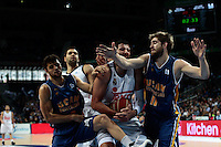 SPAIN, Madrid: Real Madrid's Greek player Ioannis Bourousis,Ucam Murcia&acute;s Montenegrin player Nemanja Radovicduring and Ucam Murcia&acute;s Brazilian player Raul Togni Neto during the Liga Endesa Basket 2014/15 match between Real Madrid and Ucam Murcia, at Palacio de los Deportes in Madrid on November 16, 2014. /NortePhoto<br />