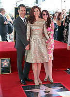 05 October 2017 - Hollywood, California - Eric McCormack, Debra Messing, Megan Mullally. Debra Messing Honored With Star On The Hollywood Walk Of Fame. <br /> CAP/ADM/FS<br /> &copy;FS/ADM/Capital Pictures