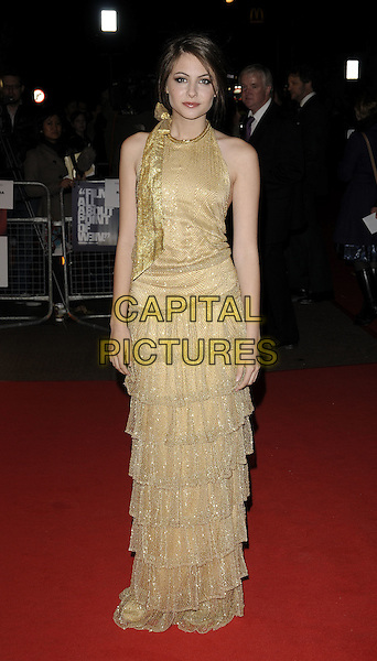 "WILLA HOLLAND .The ""Genova"" UK premiere, London Film Festival, Day 8, Odeon West End cinema, London, England..October 22nd, 2008.LFF full length gold sleeveless dress layers layered bow halterneck.CAP/CAN.©Can Nguyen/Capital Pictures."