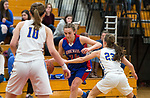 WINSTED,  CT-021919JS18-  Nonnewaug's Maddie Woodward (34) tries to drive past Housatonic's Christina Winburn (23) and Caroline Hurlburt (10) during their Berkshire League semi-final game Tuesday at Northwestern Regional High School in Winsted. <br /> Jim Shannon Republican American