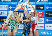 12 JUL 2014 - HAMBURG, GER - Gwen Jorgensen (USA) (centre) from the USA celebrates winning the elite women's 2014 ITU World Triathlon Series round in the Altstadt Quarter, Hamburg, Germany, with silver medalist Emma Jackson (AUS) (left) from Australia and bronze medalist Kirsten Sweetland (CAN) (right) from Canada (PHOTO COPYRIGHT © 2014 NIGEL FARROW, ALL RIGHTS RESERVED)