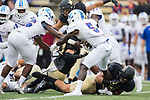 DaShawn Davis (5) of the Presbyterian Blue Hose is tackled by Luke Masterson (12) of the Wake Forest Demon Deacons during first half action at BB&T Field on August 31, 2017 in Winston-Salem, North Carolina.  The Demon Deacons defeated the Blue Hose 51-7.  (Brian Westerholt/Sports On Film)