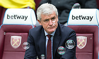 Southampton Manager Mark Hughes pre match during the EPL - Premier League match between West Ham United and Southampton at the Olympic Park, London, England on 31 March 2018. Photo by Andy Rowland.