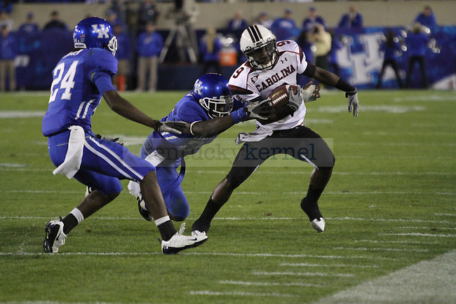 South Carolina wide receiver Ace Sanders gets pushed out of the playing field by UK's defense during the second half of UK's home game against South Carolina, Saturday, Oct. 16, 2010. Photo by Brandon Goodwin | Staff