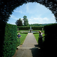 Two gardeners pruning the privet hedge in the gardens at Longleat
