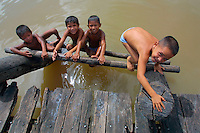 The Orinoco river is also part of the greater Amazonas region. These kids in a little village enjoy themselves looking at passengers from MS Europa during their excursion with Zodiacs.