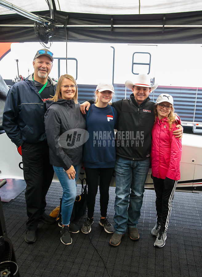 Feb 10, 2019; Pomona, CA, USA; NHRA top fuel driver Steve Torrence with guests during the Winternationals at Auto Club Raceway at Pomona. Mandatory Credit: Mark J. Rebilas-USA TODAY Sports
