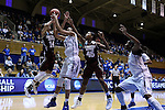 22 March 2015: Mississippi State's Kendra Grant (14) is defended by Duke's Azura Stevens (11) as Mississippi State's Chinwe Okorie (NGA) (45) and Duke's Elizabeth Williams (right) watch the play. The Duke University Blue Devils hosted the Mississippi State University Bulldogs at Cameron Indoor Stadium in Durham, North Carolina in a 2014-15 NCAA Division I Women's Basketball Tournament second round game. Duke won the game 64-56.