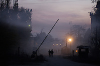 Polce check point at dusk. Srinagar, Kashmir, India. © Fredrik Naumann/Felix Features