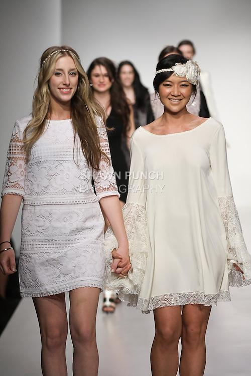 Senior fashion designer Melanie Miracolo, walks runway with model, at the close of the Pratt 2011 fashion show.