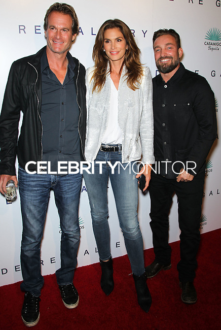 WEST HOLLYWOOD, CA, USA - OCTOBER 23: Rande Gerber, Cindy Crawford, Brian Bowen Smith arrive at Brian Bowen Smith's First Solo Show 'Wildlife' held at the De Re Gallery on October 23, 2014 in West Hollywood, California, United States. (Photo by Celebrity Monitor)