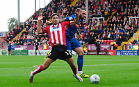Lincoln City's Tyler Walker vies for possession with Sunderland's Joel Lynch, but his appeals for a penalty were turned down<br /> <br /> Photographer Chris Vaughan/CameraSport<br /> <br /> The EFL Sky Bet League One - Lincoln City v Sunderland - Saturday 5th October 2019 - Sincil Bank - Lincoln<br /> <br /> World Copyright © 2019 CameraSport. All rights reserved. 43 Linden Ave. Countesthorpe. Leicester. England. LE8 5PG - Tel: +44 (0) 116 277 4147 - admin@camerasport.com - www.camerasport.com