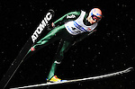 Michael Neumeyer of Germany soars through the night skies during the FIS World Cup Ski Jumping in Sapporo, northern Japan in February, 2008.