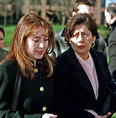 Lorena Bobbitt, 28, left, now known as Lorena Gallo, who achieved notoriety when she cut off her husband John's penis with a knife while he was asleep in bed in June 1993, leaves the Prince William County Courthouse in Manassas, Virginia with her mother, Elvia Gallo, 49, right, on December 8, 1997.  Mrs. Gallo had accused her daughter of simple assault after suffering a abrasion around the eyes and minor scratches in an attack in their Prince William home.<br /> Credit: Ron Sachs / CNP