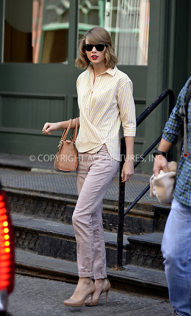 WWW.ACEPIXS.COM<br /> <br /> April 10 2014, New York City<br /> <br /> Taylor Swift leaves her Tribeca apartment on April 10 2014 in New York City<br /> <br />  Curtis Means/ACE Pictures<br /> <br /> <br /> ACE Pictures, Inc.<br /> tel: 646 769 0430<br /> Email: info@acepixs.com<br /> www.acepixs.com