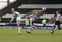 Leigh Griffiths flicks the ball on watched by Marc McAusland (centre) and Lee Mair in the St Mirren v Hibernian Clydesdale Bank Scottish Premier League match played at St Mirren Park, Paisley on 29.4.12.
