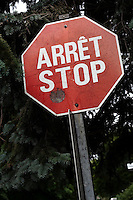 """One of the last French-English bilingual """"stop"""" sign is seen on Rue de Berniere street in Quebec city July 7, 2009. Provincial government changed (almost) all the stop sign to only read """"arret"""" many years ago."""