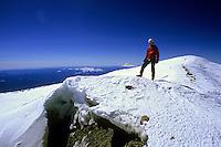 Rob Hahn standing on top of Mt Rainier, at 4,392m the highest peak of Northwestern USA.