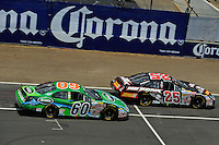 04/20/08 Mexico City .The Ford Fusions of Boris Said and Carl Edwards duel during the opening laps.