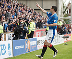 Graham Dorrans celebrates and points to his Rangers badge after scoring