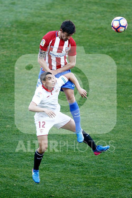 Atletico de Madrid's Stefan Savic (t) and Sevilla FC's Wissam Ben Yedder during La Liga match. March 19,2017. (ALTERPHOTOS/Acero)