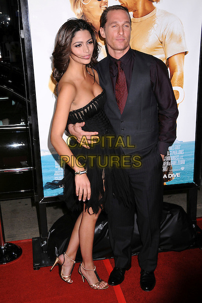 "CAMILLA ALVES & MATTHEW McCONAUGHEY.""Fool's Gold"" Los Angeles Premiere at Grauman's Chinese Theatre, Hollywood, California, USA..January 30th, 2008.full length blue waistcoat black dress hand in pocket arm around waist couple fiancee gold shoes clutch bag purse strapless sheer shredded windy.CAP/ADM/BP.©Byron Purvis/AdMedia/Capital Pictures."