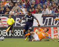 Houston Dynamo defender Richard Mulrooney (8) slide tackles New England Revolution forward Khano Smith (18). The New England Revolution defeated Houston Dynamo, 1-0, at Gillette Stadium on August 14, 2010.