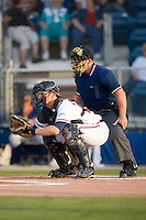 Home plate umpire Jeff Klinghoffer sets up behind Danville Braves catcher Mathew Kennelly (23) at Dan Daniels Park in Danville, VA, Saturday, August 23, 2008. (Photo by Brian Westerholt / Four Seam Images)