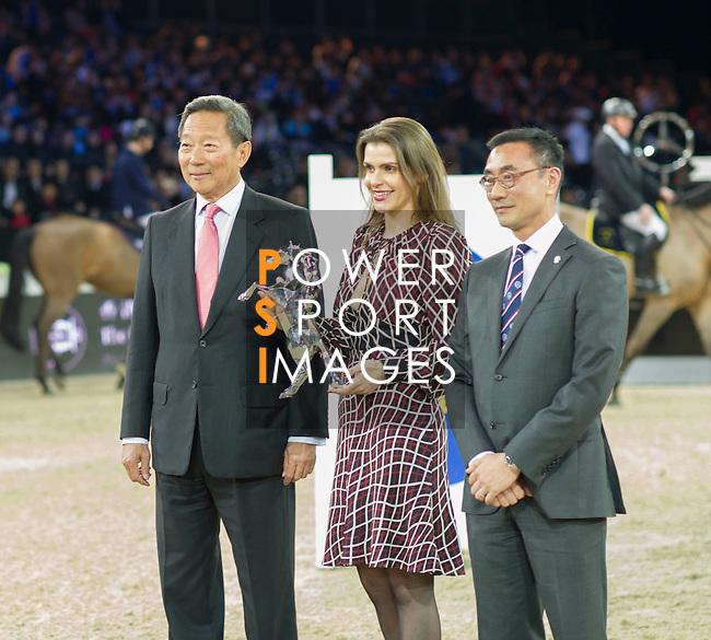 DR. Simon S O Ip, Chairman of The Hong Kong Jockey Club. Mr. Michel Lee, President Hong Kong Equestrian Federation.  The Hong Kong Jockey Club Trophy during the Longines Masters of Hong Kong on 19 February 2016 at the Asia World Expo in Hong Kong, China. Photo by Moses Ng / Power Sport Images