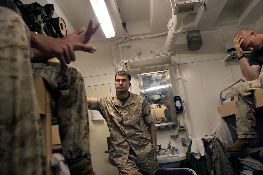 In their stateroom, Lts. Seth Moulton (c.) and Jeremy T. Sellars (r.) - platoon commanders for Charlie Co. 1/4 Marines -  discuss with Co. Executive Officer Lt. Larry Costa how best to address with their subordinates, issues raised by a memo issued by a higher-up in the battalion which paints an unfavorable picture of adherents of the Islamic faith. Decisions and opinions expressed by lieutenants and senior non-commissioned officers have the greatest effect on the enlisted Marines over whom and with whom they have the greatest amount of control and interaction.