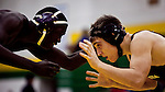 hamiltonp11 - Mouhamed Falls (left) of Bradley Tech battles Max Nelson of Wauwatosa, in Milwaukee on Thursday, December 23, 2010. Photographed by MARK ABRAMSON/MABRAMSON@JOURNALSENTINEL.COM