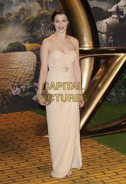 Rachel Weisz.attended the 'Oz The Great & Powerful' UK film premiere, Empire cinema, Leicester Square, London, England, UK, 28th February 2013..full length strapless beige gold dress belt clutch bag ruched sparkly long maxi cream  .CAP/CAN.©Can Nguyen/Capital Pictures.